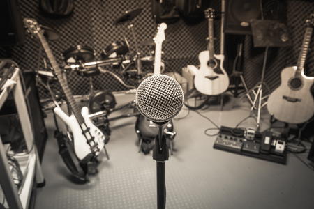 Photo pour selective focus microphone and blur musical equipment guitar ,lyric, drum piano background. - image libre de droit