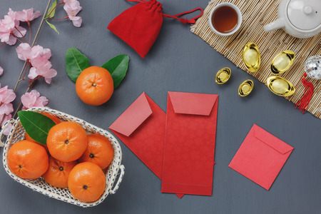 Photo for Overhead view sign of Chinese Happy new year festival concept.Different object on the modern grey rustic table wood office desk background.Essential items for sacrificial offering to the season. - Royalty Free Image
