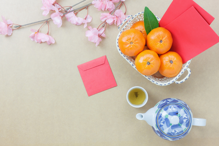 Photo for Overhead view of essential items Chinese & Lunar new year background concept.Orange and difference items for festive season.Variety objects on the modern rustic wood at home studio.Copy space design. - Royalty Free Image