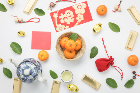 Photo pour Top view aerial image shot of arrangement decoration Chinese new year & lunar new year holiday background concept.Flat lay fresh orange with food & drink on modern white wooden at home office desk. - image libre de droit