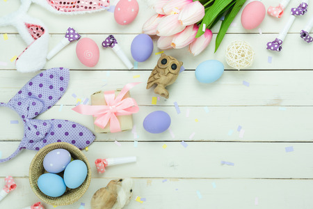 Table top view shot of decoration Happy Easter holiday background concept.Flat lay variety bunny eggs with flower on modern rustic white plank wood.Copy space for creative design web and mock up.