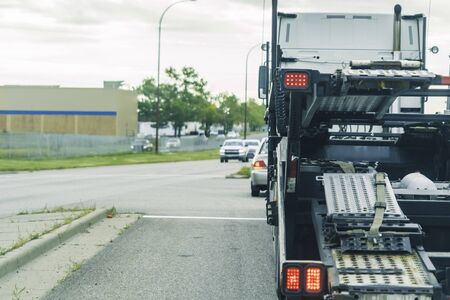 Photo for Motor Vehicle car transporter at road intersection - Royalty Free Image