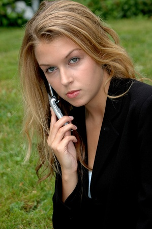 Real estate agent calling a client to show a house.