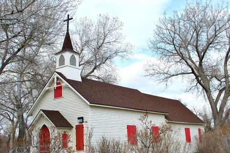 Old wooden church in a country setting.
