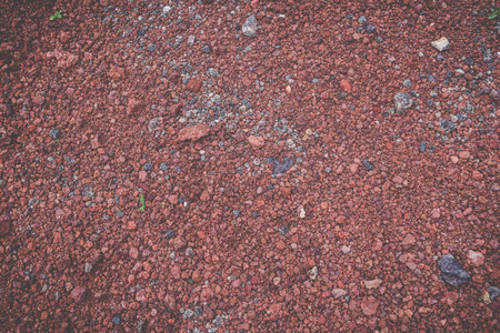 Crushed red lava rock floor texture background