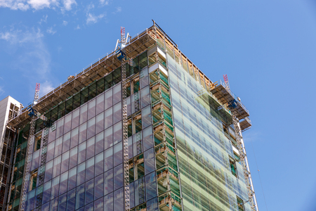 View of a modern building under construction, on a sunny summer day