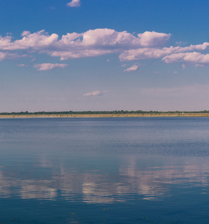 Relaxing water landscape with clouds reflections