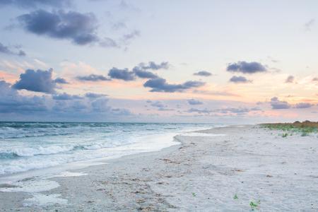 Sandy empty sea coastal seaview, cloudy colourful sunrise sky view
