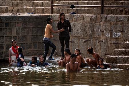 JAIPUR, INDIA - NOVEMBER 9, 2017: Group of Indian children bathe outside