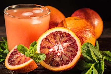 Glass of fresh blood orange juice, selective focus