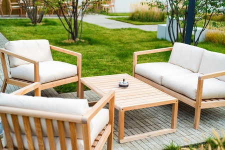 Photo for Outdoor patio with wooden armchairs and table - Royalty Free Image
