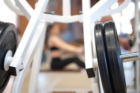 Photo for Fitness dumbbell and barbell weight plates of exercise machine in gym - Royalty Free Image