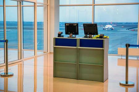 Photo pour Empty little check-in desks with computers in airport - image libre de droit