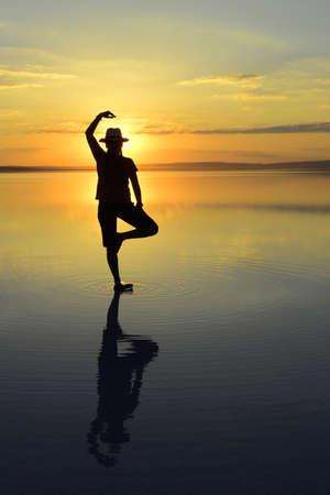 Photo pour sunset meditation and reflection. Sunset, Salt Lake Aksaray, Turkey. - image libre de droit