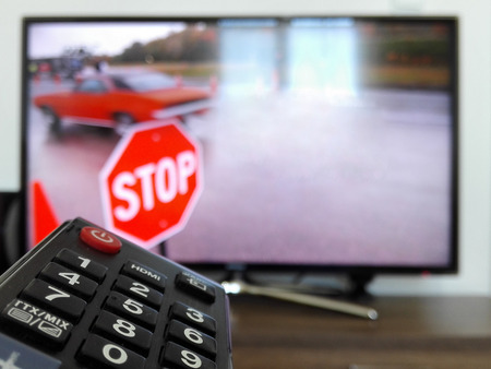 watching tv and remote control tv