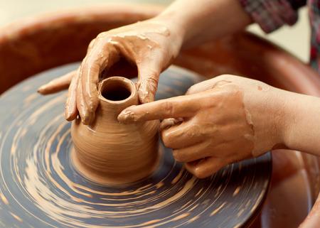 Photo pour Hands working on pottery wheel - image libre de droit
