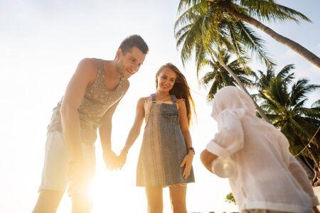 Photo pour happy family playing at sunset - image libre de droit