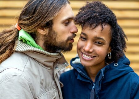 Photo for guy with an african  girl in love hugging  in autumn park walk at sunset - Royalty Free Image