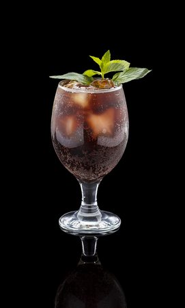 Rum and Cola Cuba Libre with Lime and Ice ver black background