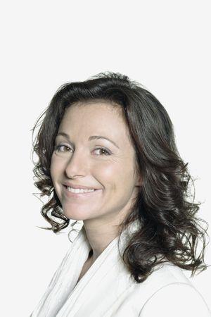 Foto de portrait on white background of a forty years old woman in studio smiling wearing a white vest - Imagen libre de derechos