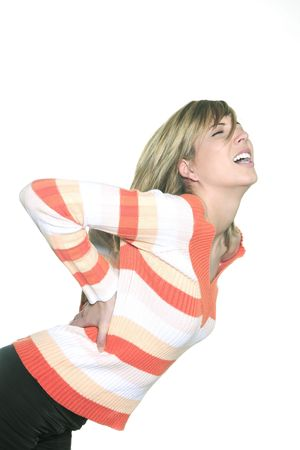 Photo pour portrait in studio on a white background of a young blond caucasian expressive woman screaming  and holding her back - image libre de droit