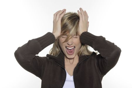 Photo pour portrait in studio on a white background of a young blond caucasian expressive woman screaming having a headache and holding her head - image libre de droit
