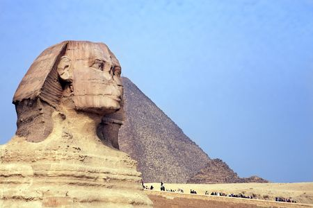 view of the sphynx with the pyramids of gizah near cairo in egypt