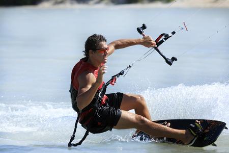 Foto de young and talented kitesurfer in brazil tatajuba, Jericoacoara,ceara - Imagen libre de derechos