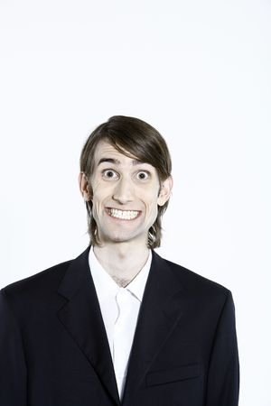 studio shot portrait of a young funny expressive thin and tall man on isolated background