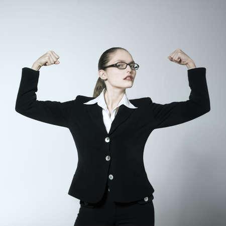 Photo pour studio shot portrait of a beautiful young woman in a costume suit feeling strong - image libre de droit