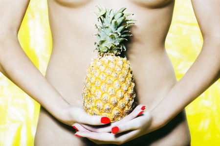 beautiful woman portrait with colorful make-up  and background holding pineapple