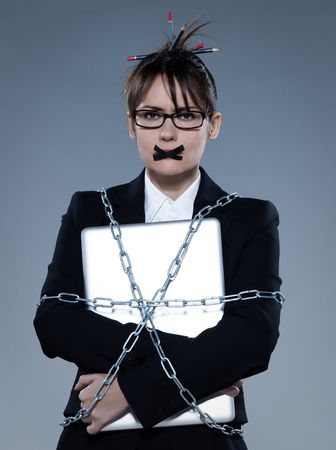 beautiful business woman on isolated bacground chained to  her laptop
