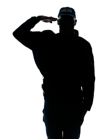 Foto per Silhouette one policeman saluting in studio on white isolated background - Immagine Royalty Free