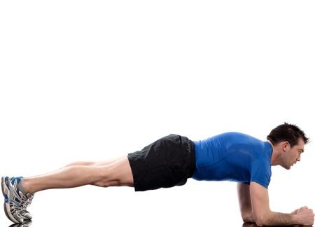 Foto de man on Abdominals workout Basic Plank posture on white background - Imagen libre de derechos