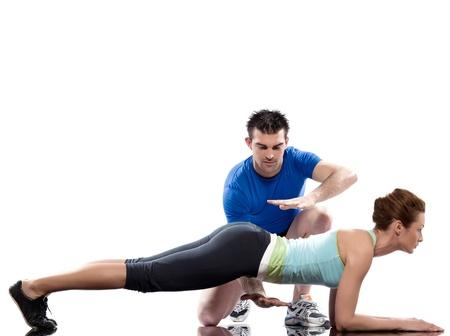 Foto de one caucasian couple man aerobic trainer positioning woman  Workout coach Posture in indoors studio isolated on white background - Imagen libre de derechos