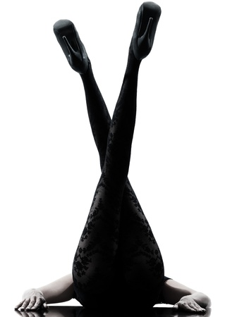Photo pour one woman legs silhouette on studio isolated white background - image libre de droit