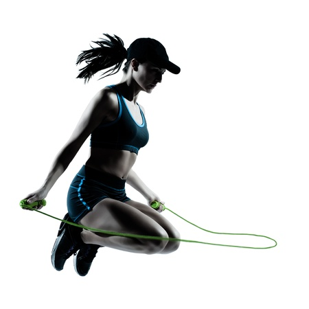 Photo for one caucasian woman runner jogger jumping rope in silhouette studio isolated on white background - Royalty Free Image