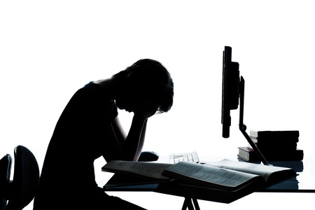 Photo pour one caucasian young teenager silhouette boy or girl studying with computer computing laptop tired sad despair in studio cut out isolated on white background - image libre de droit
