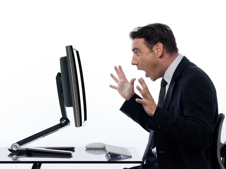 one caucasian business man  computing and a computer display monitor on isolated white background