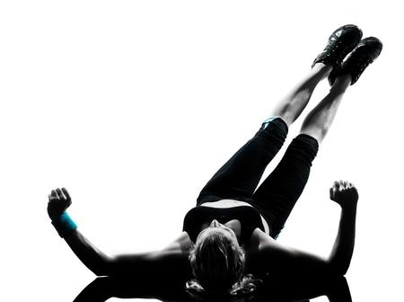Foto de one woman exercising workout fitness aerobic exercise abdominals push ups posture on studio isolated white background - Imagen libre de derechos