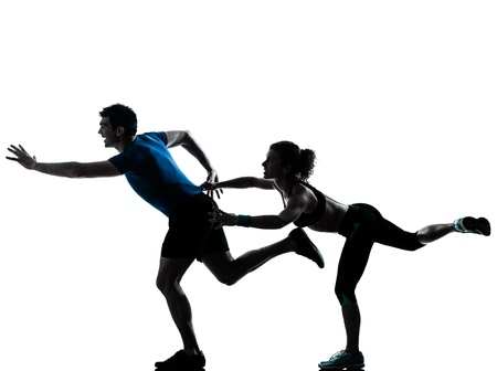 one caucasian couple man woman personal trainer coach runner running jogging sprinting silhouette studio isolated on white background
