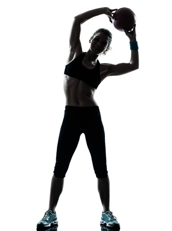 Foto de one caucasian woman exercising fitness ball workout posture in silhouette studio isolated on white background - Imagen libre de derechos