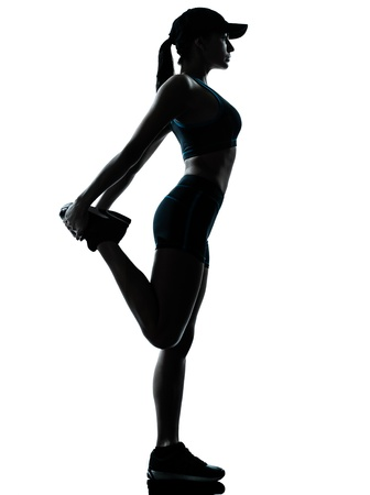one caucasian woman runner jogger stretching legs in silhouette studio isolated on white bac