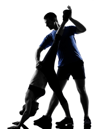 couple woman man exercising workout fitness aerobics posture in silhouette studio isolated on white backgroundの写真素材