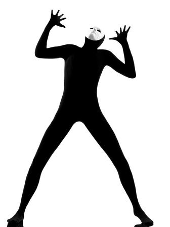 performer man mime with mask complaigning looking up on studio isolated on white background