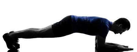 Foto de man exercising push ups workout fitness aerobics posture in silhouette studio isolated on white background - Imagen libre de derechos