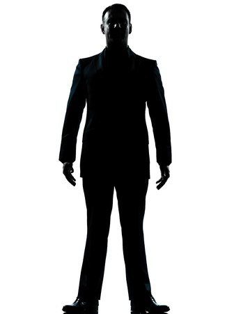 one caucasian business man silhouette standing Full length in studio isolated on white background