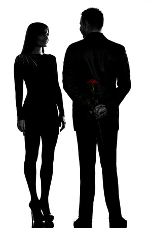 one caucasian couple man and woman smiling in studio silhouette isolated on white background