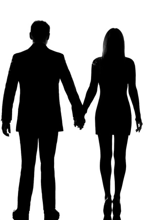 one lovers caucasian couple man and woman standing hand in hand in studio silhouette isolated on white background