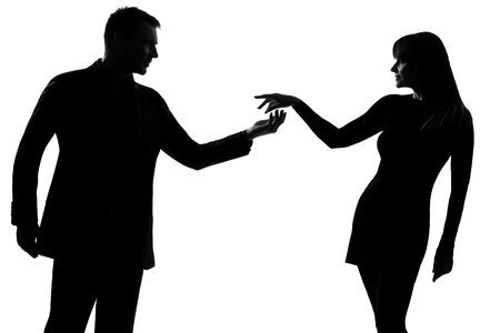 Photo for one caucasian couple man holding out inviting hand in hand  woman in studio silhouette isolated on white background - Royalty Free Image